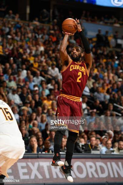 Cleveland Cavaliers guard Kyrie Irving takes a shot during the third quarter against the Denver Nuggets on March 22 2017 in Denver Colorado at Pepsi...