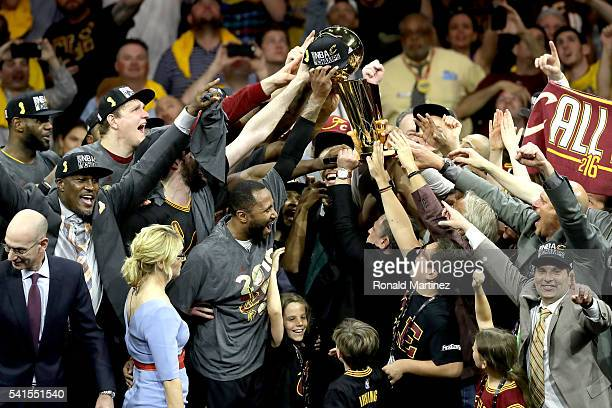 Cleveland Cavaliers owner Dan Gilbert holds the Larry O'Brien Championship Trophy after the Cavaliers defeated the Golden State Warriors 9389 in Game...
