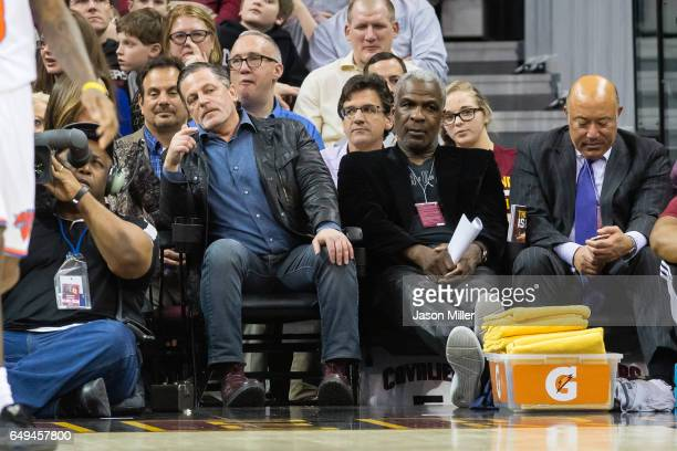 Cleveland Cavaliers owner Dan Gilbert sits next to former NBA player Charles Oakley during the game between the Cleveland Cavaliers and the New York...