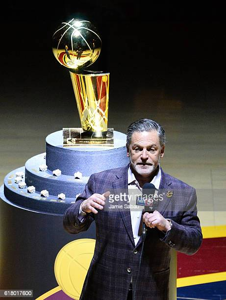 Cleveland Cavaliers owner Dan Gilbert speaks in front of the Larry O'Brien championship trophy before a game against the New York Knicks at Quicken...
