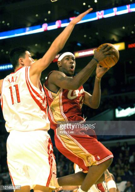 Cleveland Cavaliers rookie LeBron James the No 1 pick in the 2003 NBA draft drives to the basket against Yao Ming of the Houston Rockets during the...