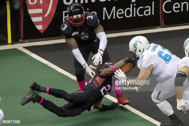 Cleveland Gladiators DB Kenny Veal dives into the end zone as he scores on a 13yard interception return during the third quarter of the Arena...