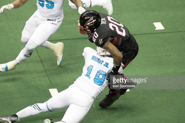 Cleveland Gladiators DB Kenny Veal is tackled by Philadelphia Soul LB Joe Goosby as he returns a kickoff during the fourth quarter of the Arena...