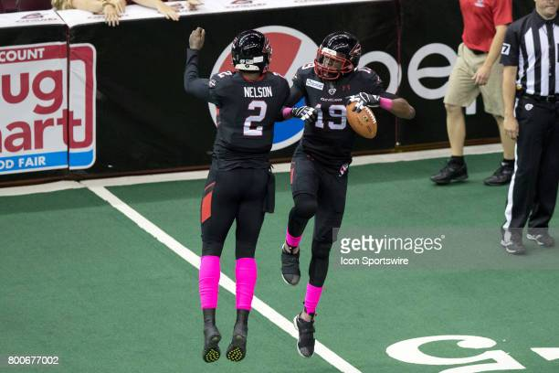 Cleveland Gladiators QB Arvell Nelson and Cleveland Gladiators WR Michael Preston celebrate after they combined on a 6yard touchdown play during the...