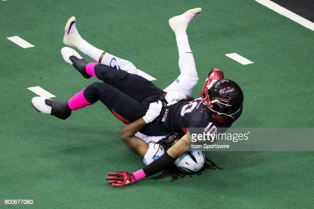Cleveland Gladiators WR Lonnie Outlaw is tackled by Philadelphia Soul DB Dwayne Hollis after making a catch during the third quarter of the Arena...