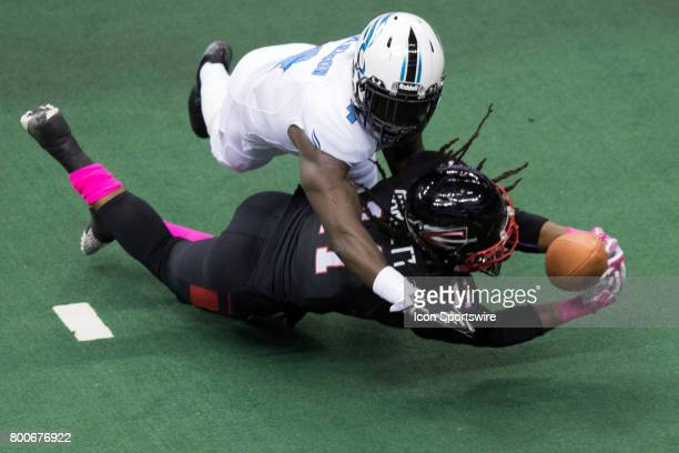 Cleveland Gladiators WR Phillip Barnett makes a diving catch as Philadelphia Soul DB Kent Richardson defends during the third quarter of the Arena...