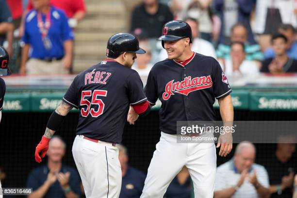 Cleveland Indians catcher Roberto Perez is congratulated by Cleveland Indians right fielder Jay Bruce after hitting a 3run home run during the second...
