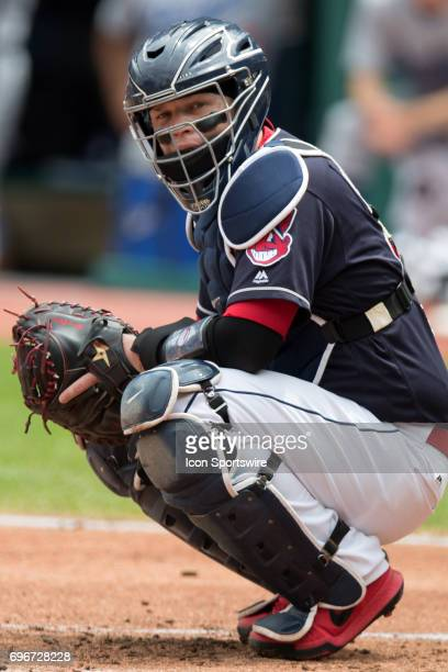 Cleveland Indians catcher Roberto Perez looks to the dugout for a sign during the first inning of the Major League Baseball Interleague game between...