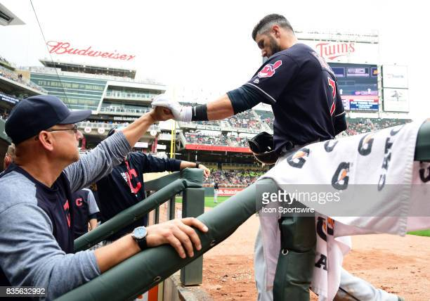 Cleveland Indians Catcher Yan Gomes and Cleveland Indians Manager Terry Francona share a pound after Gomes hit a 3run home run during game 1 of a MLB...