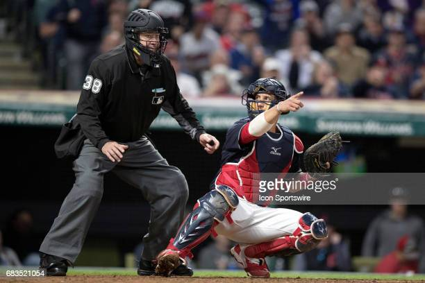 Cleveland Indians Catcher Yan Gomes asks home plate umpire Gary Cederstrom to appeal a check swing call to the first base umpire during the eighth...