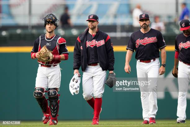 Cleveland Indians catcher Yan Gomes Cleveland Indians starting pitcher Corey Kluber and Cleveland Indians pitching coach Mickey Callaway walk in from...