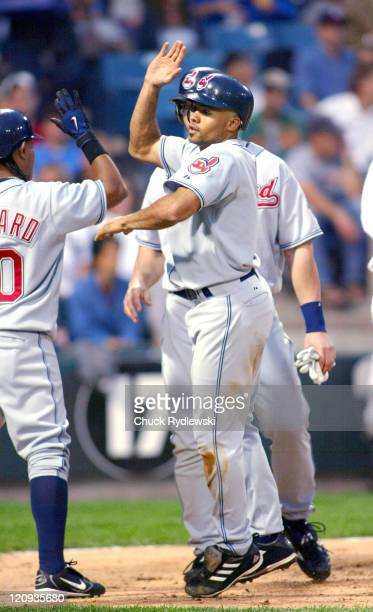 Cleveland Indians Center Fielder Coco Crisp gets high fives from teammates after hitting 3rd inning home run during the game against the Chicago...