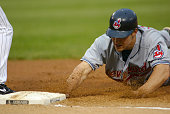 Cleveland Indians Center Fielder Grady Sizemore dives into 1st base during the game against the Chicago White Sox June 3 2005 at US Cellular Field in...