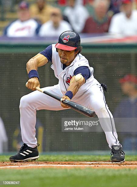 Cleveland Indians' Coco Crisp attempts a bunt during the game against the Minnesota Twins Sunday April 17 2005 at Jacobs Field in Cleveland The...