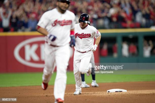 Cleveland Indians designated hitter Edwin Encarnacion and Cleveland Indians right fielder Jay Bruce circle the bases after Bruce hit a 2run home run...
