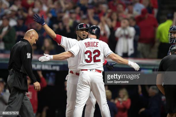 Cleveland Indians designated hitter Edwin Encarnacion and Cleveland Indians right fielder Jay Bruce celebrate after Bruce hit a 2run home run during...