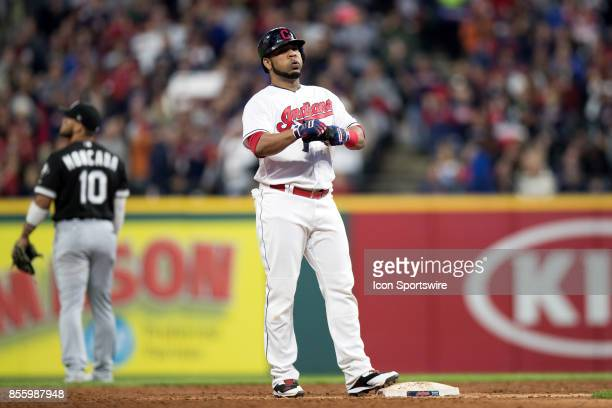 Cleveland Indians designated hitter Edwin Encarnacion at second base after driving in 3 runs with a bases loaded triple during the third inning of...