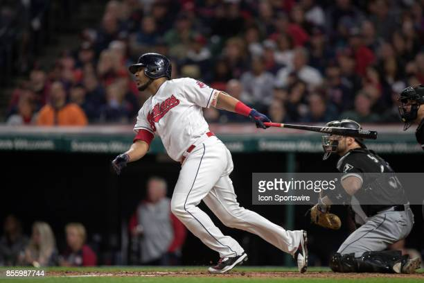Cleveland Indians designated hitter Edwin Encarnacion clears the bases with a bases loaded triple during the third inning of the the Major League...