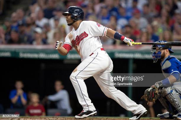 Cleveland Indians designated hitter Edwin Encarnacion doubles to center to drive in 2 runs during the fifth inning of the Major League Baseball game...