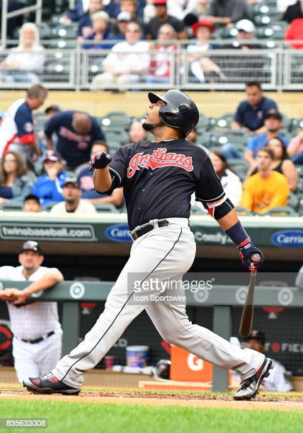 Cleveland Indians Designated hitter Edwin Encarnacion hits a fly ball during game 1 of a MLB splitdoubleheader between the Minnesota Twins and...