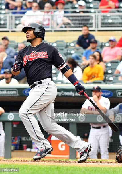 Cleveland Indians Designated hitter Edwin Encarnacion hits a line drive during game 1 of a MLB splitdoubleheader between the Minnesota Twins and...
