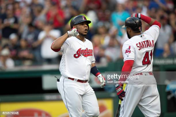 Cleveland Indians designated hitter Edwin Encarnacion is greeted by Cleveland Indians first baseman Carlos Santana after hitting a home run during...