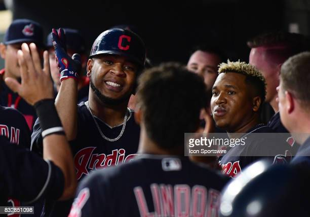Cleveland Indians Designated hitter Edwin Encarnacion is highfived by teammates after hitting a solo home run during a MLB game between the Minnesota...