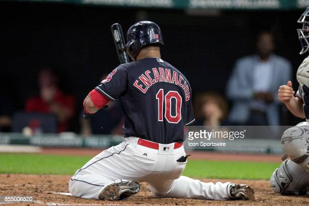 Cleveland Indians designated hitter Edwin Encarnacion is on his knees after ducking out of the way of an inside pitch for ball four during the fifth...
