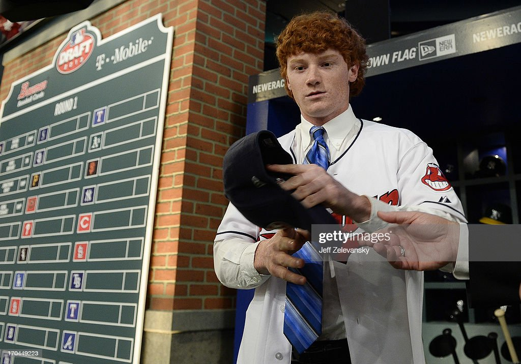 Cleveland Indians draftee Clint Frazier poses by the draft board at the 2013 MLB First-Year Player Draft at the MLB Network on June 6, 2013 in Secaucus, New Jersey.