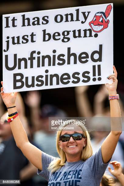 Cleveland Indians fan holds a sign behind the Indians dugout during the third inning of the Major League Baseball game between the Kansas City Royals...