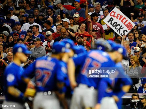 Cleveland Indians fan holds up a sign as the Chicago Cubs meet on the pitcher's mound in the third inning of Game 7 of the World Series on November 2...