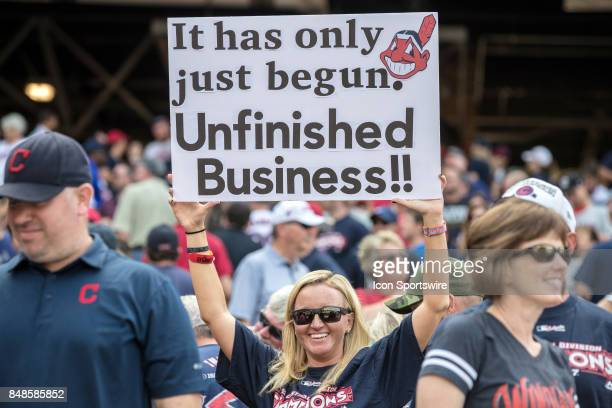 Cleveland Indians fan holds up a sign in celebration after the Major League Baseball game between the Kansas City Royals and Cleveland Indians on...
