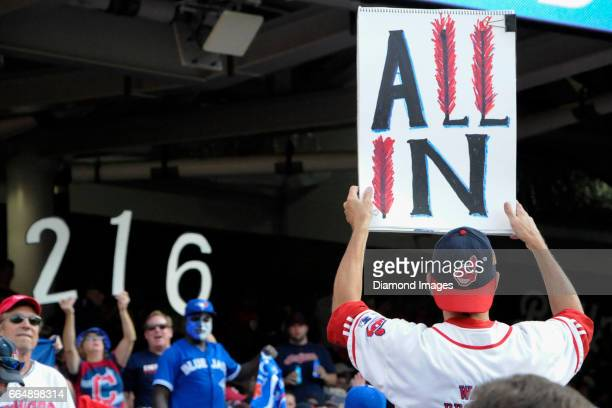 Cleveland Indians fans hold up signs during Game 2 of the American League Championship Series against the Toronto Blue Jays on October 15 2016 at...