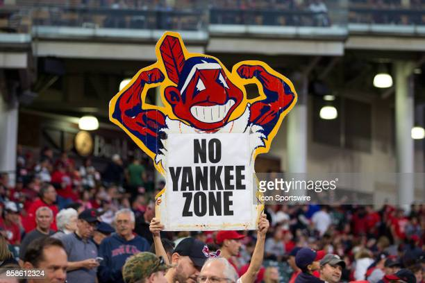 Cleveland Indians fans hold up signs during the 2017 American League Divisional Series Game 1 between the New York Yankees and Cleveland Indians on...