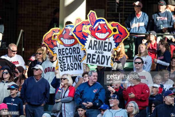 Cleveland Indians fans hold up signs during the seventh inning of the Major League Baseball game between the Chicago White Sox and Cleveland Indians...
