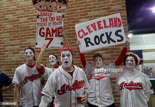 Cleveland Indians fans hold up signs prior to Game Seven of the 2016 World Series between the Chicago Cubs and the Cleveland Indians at Progressive...