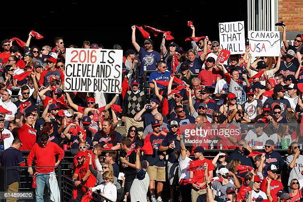 Cleveland Indians fans hold up signs prior to the start of game two of the American League Championship Series against the Toronto Blue Jays at...