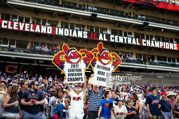 Cleveland Indians fans holds up a signs in celebration after the Major League Baseball game between the Kansas City Royals and Cleveland Indians on...