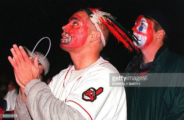 Cleveland Indians fans Pedro Rodriguez and Pete Bogdan watch the Indians play the Florida Marlins in game 7 of the World Series 26 October in...