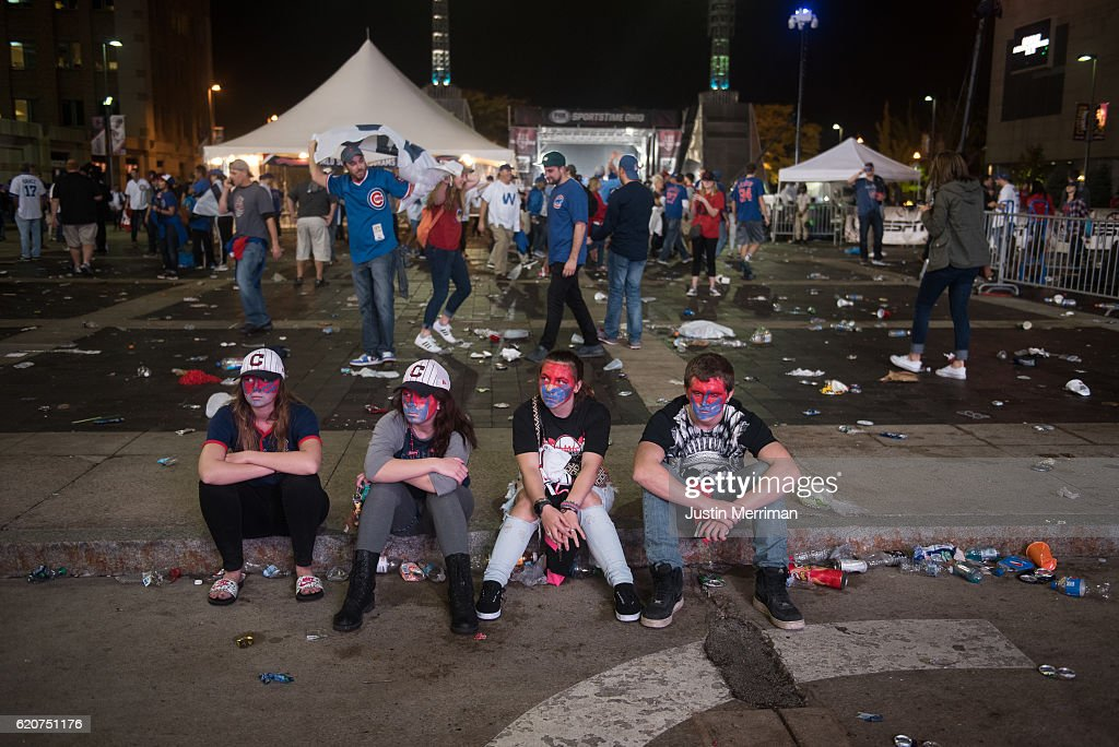 Cleveland Indians fans sit outside of Progressive Field after the Chicago Cubs beat the Cleveland Indians in game 7 of the World Series in the early morning hours on November 3, 2016 in Cleveland, Ohio. The Cubs defeated the Indians 8-7 in 10 innings to win their first World Series championship in 108 years.
