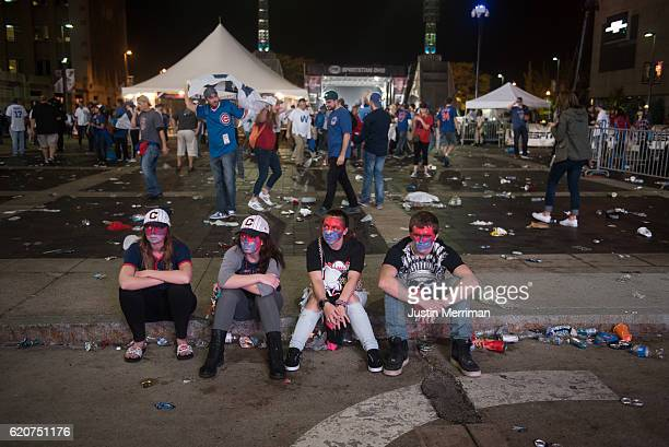 Cleveland Indians fans sit outside of Progressive Field after the Chicago Cubs beat the Cleveland Indians in game 7 of the World Series in the early...