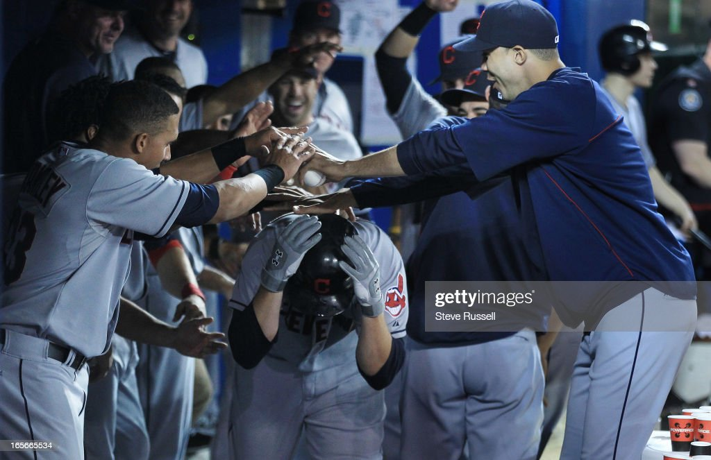 Cleveland Indians first baseman Mark Reynolds runs the gauntlet in the dugout after hitting a homer as the Toronto Blue Jays play the Cleveland Indians at the Rogers Centre in Toronto.