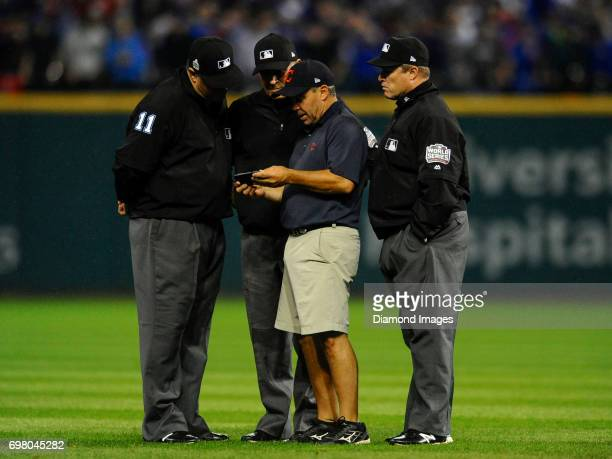 Cleveland Indians head groundskeeper Brandon Koehnke watches a radar with umpires in the ninth inning of Game 7 of the World Series between the...