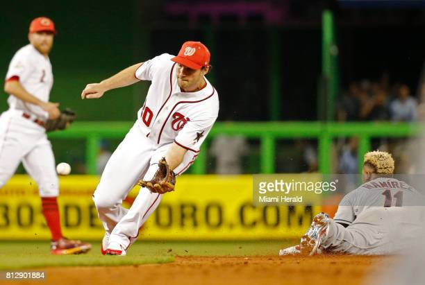 Cleveland Indians' Jose Ramirez slides into second as the Washington Nationals second baseman Daniel Murphy fields the ball during the MLB AllStar...