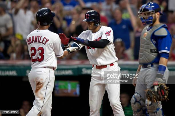 Cleveland Indians left fielder Michael Brantley and Cleveland Indians infielder Erik Gonzalez celebrate after they both scored on the double hit by...