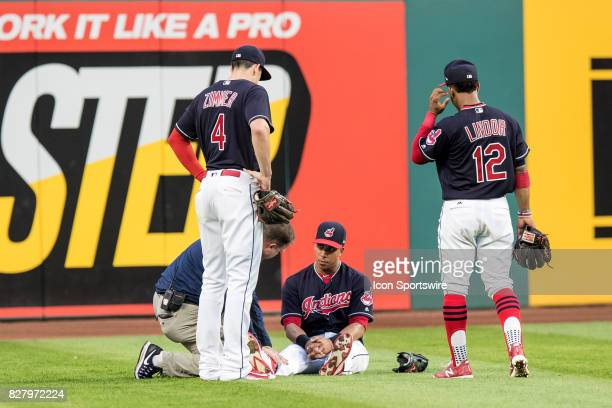 Cleveland Indians left fielder Michael Brantley is examined by a trainer after suffering an apparent lower body injury as Cleveland Indians...
