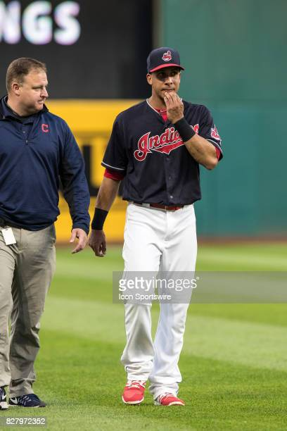 Cleveland Indians left fielder Michael Brantley leaves the field with an apparent lower body injury during the fifth inning of the Major League...