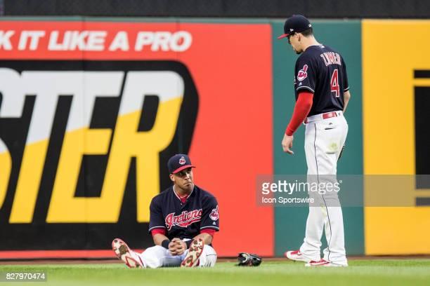 Cleveland Indians left fielder Michael Brantley sits on the turf as Cleveland Indians outfielder Bradley Zimmer looks on after suffering an apparent...