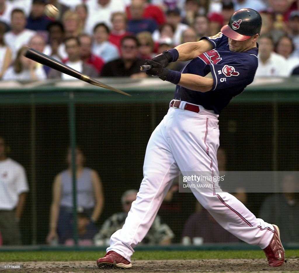 Cleveland Indians left fielder Russell Branyan breaks his bat on a single to center field off of Seattle Mariners pitcher Paul Abbott during the...
