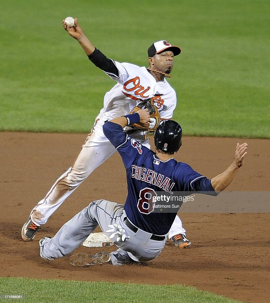 Cleveland Indians' Lonnie Chisenhall breaks up a 9th-inning double play by Baltimore Orioles' Alexi Casilla at Oriole Park at Camden Yards in Baltimore, Maryland, Wednesday, June 26, 2013.